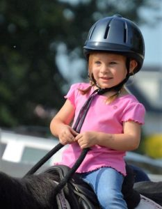 young horse riding lessons student